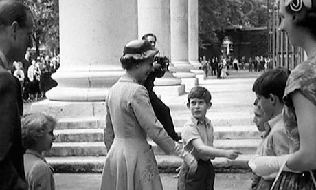 Prince Charles takes his mother to sports day at Hill House school, west London, in 1957.